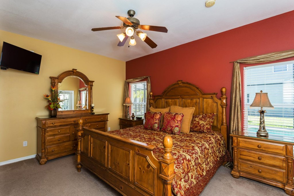 Gorgeous downstairs main king master suite with French door pool access and 32-inch LED TV/DVD combo