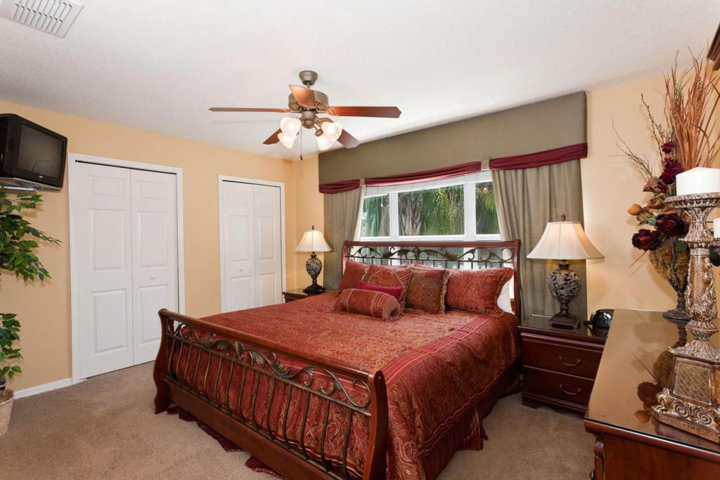 Decorative upstairs king master suite 2 with TV/DVD combo & ceiling fan