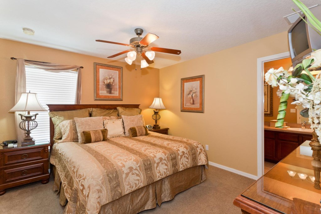 Quaint upstairs king master suite 3 with TV/DVD combo & ceiling fan