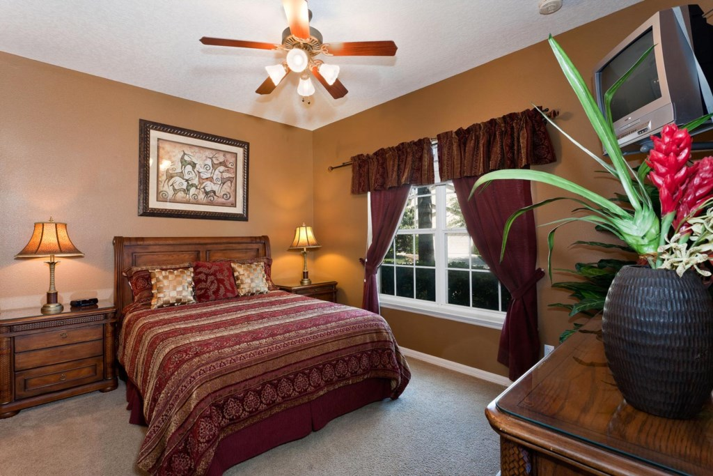 Stylish downstairs queen master suite 5 with TV/DVD combo & ceiling fan