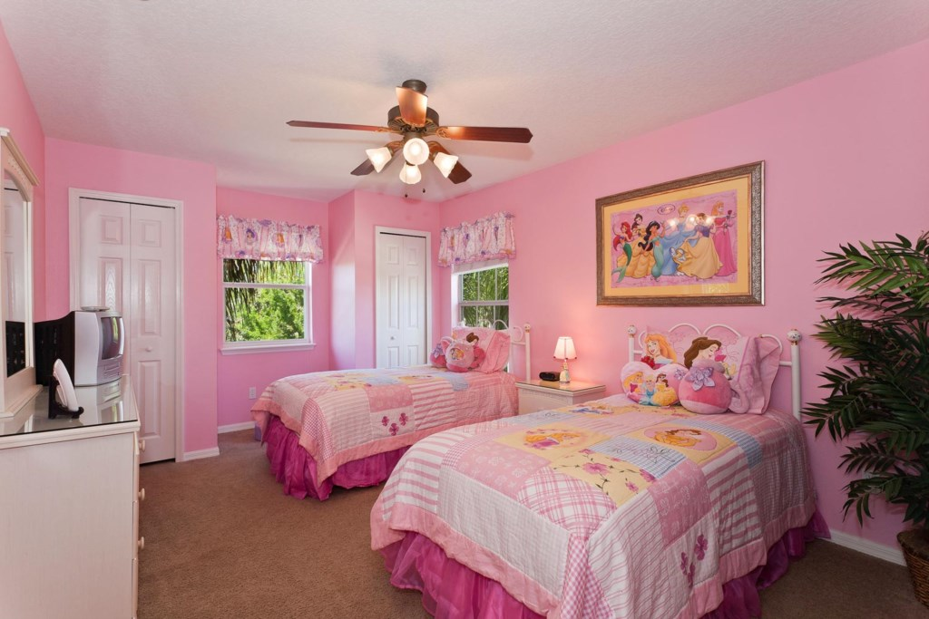 Charming upstairs princess-themed twin bedroom 6 with TV/DVD combo & ceiling fan
