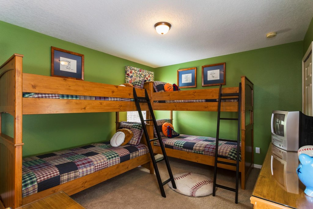 Fun upstairs twin bunk bedroom 7 with sports decor plus TV/DVD combo