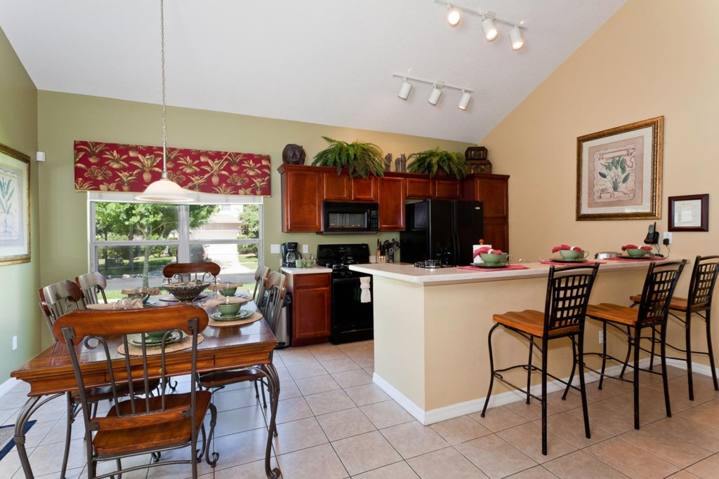 Convenient dining area is right next to the kitchen