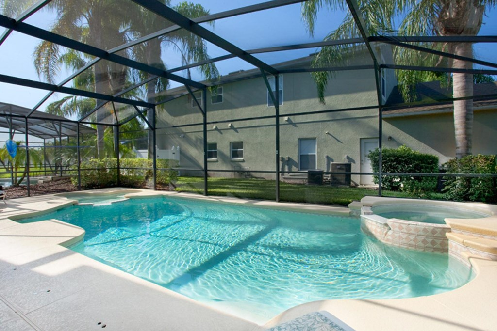East-facing pool and spa with luxury patio furniture, kiddie pool, pool shower & gas barbecue grill