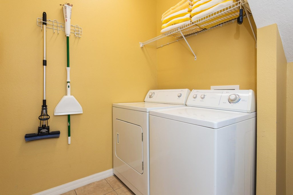 The laundry room features a full-size washer and dryer