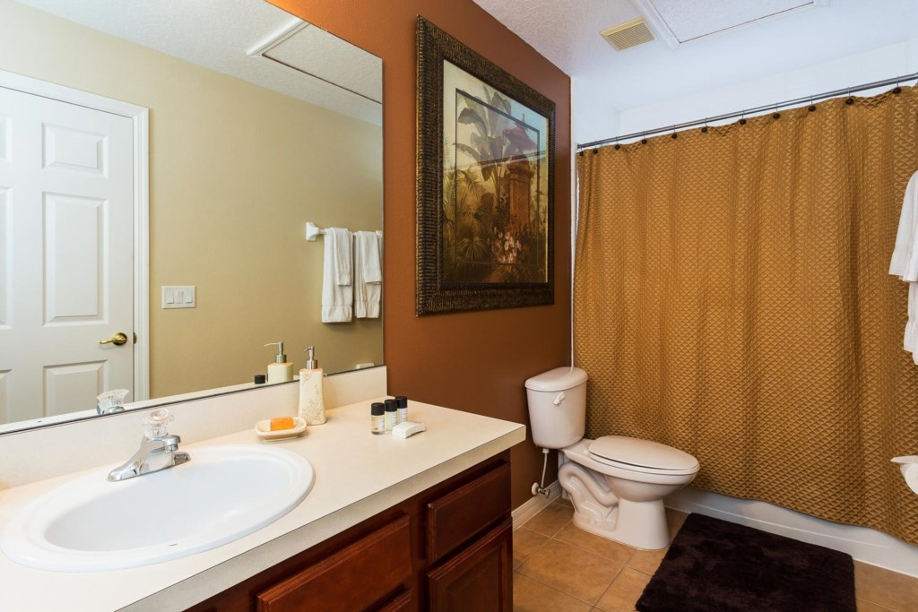 Upstairs suite 3 private bathroom 3 features a bathtub & shower