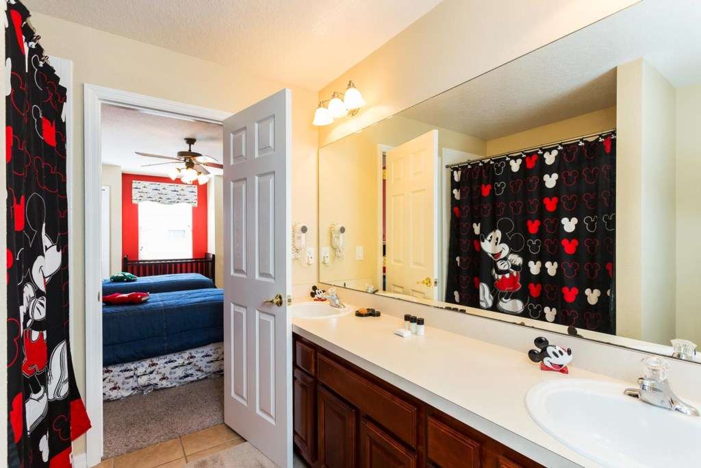 Upstairs shared bathroom 6 with vintage Mickey decor, 2 sinks plus a full bathtub & shower