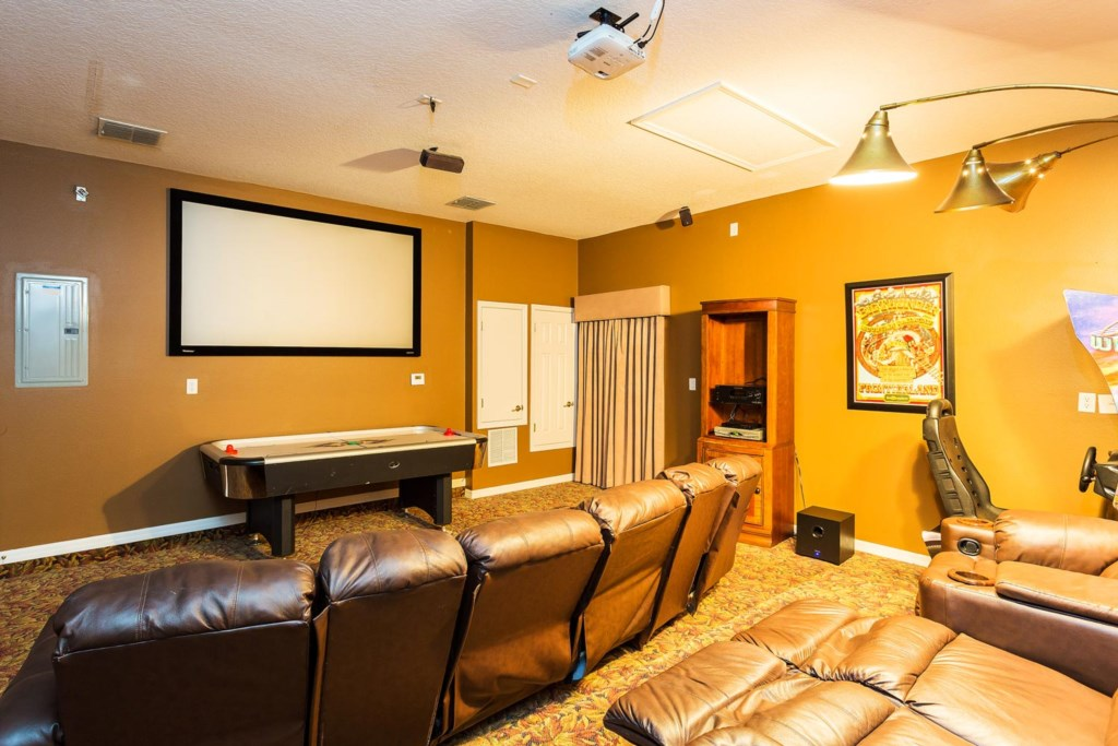 Hours of hi-tech fun await in the home theater/game room