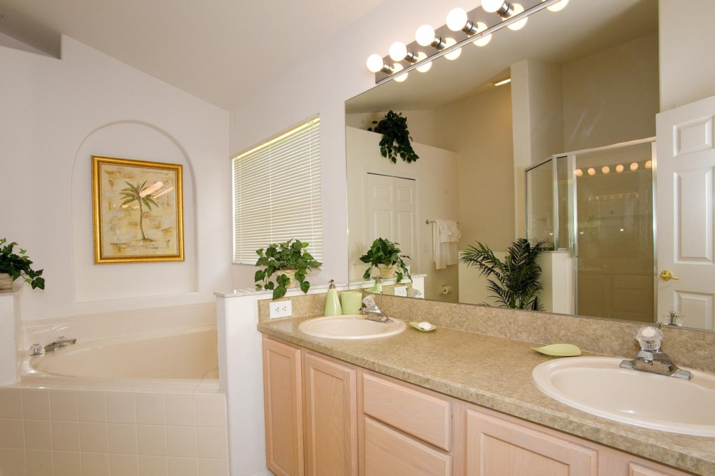 Master suite 1 bathroom with garden tub & glass door shower