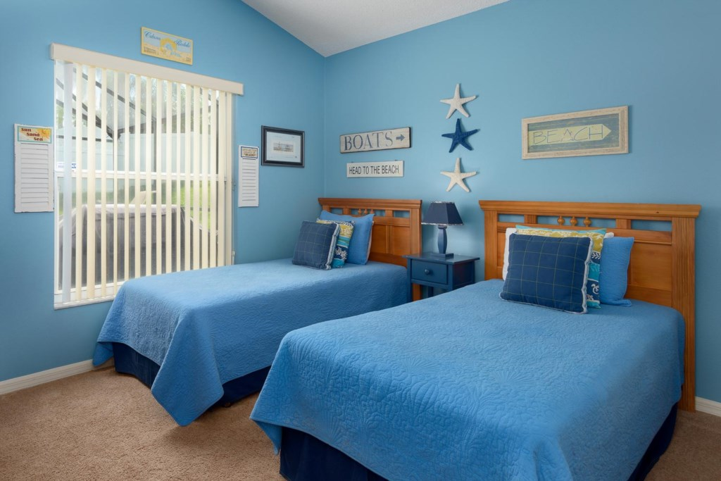 Quaint twin bedroom 4 features nautical accents
