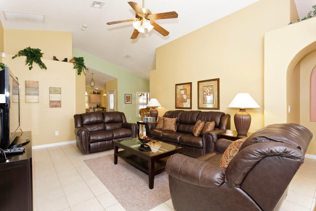 Gather for a movie favorite in the spacious living area with 50-inch flat-screen TV, PlayStation 2 a