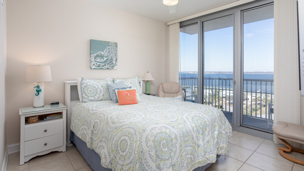 Third bedroom with queen size bed and small balcony