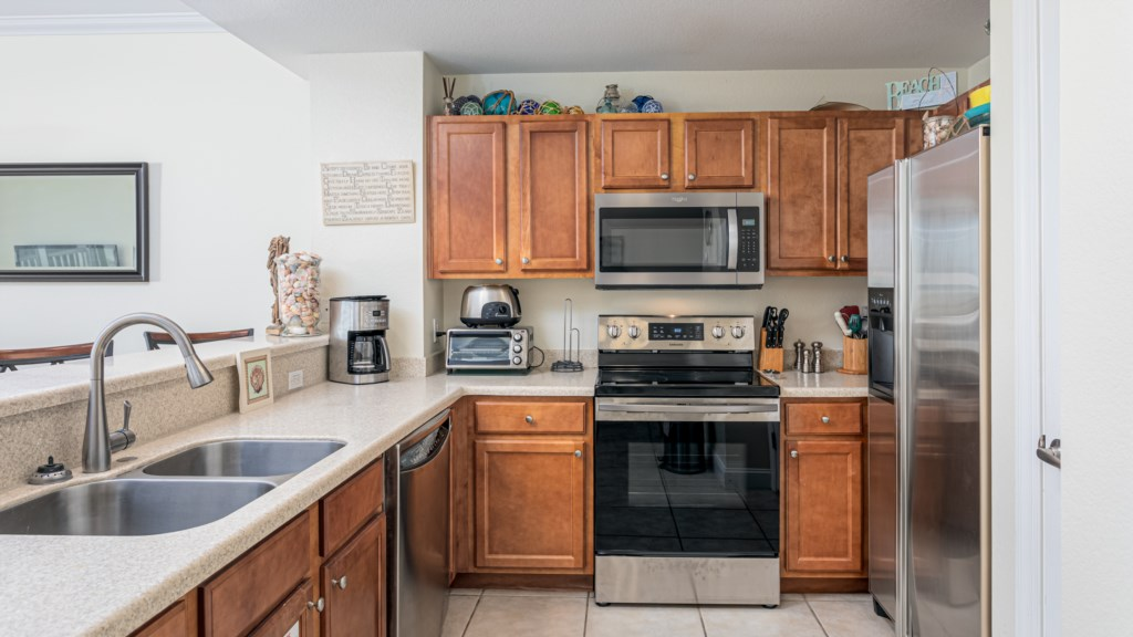 Fully stocked kitchen with regular coffee pot