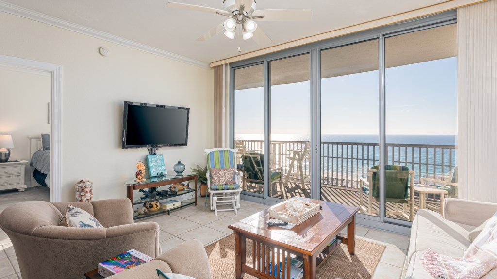 Flat screen TV and great views in this living room