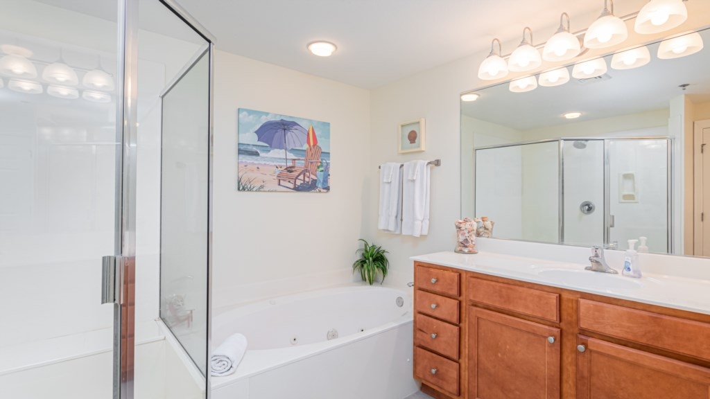 Master bathroom has a separate shower and oversized tub.