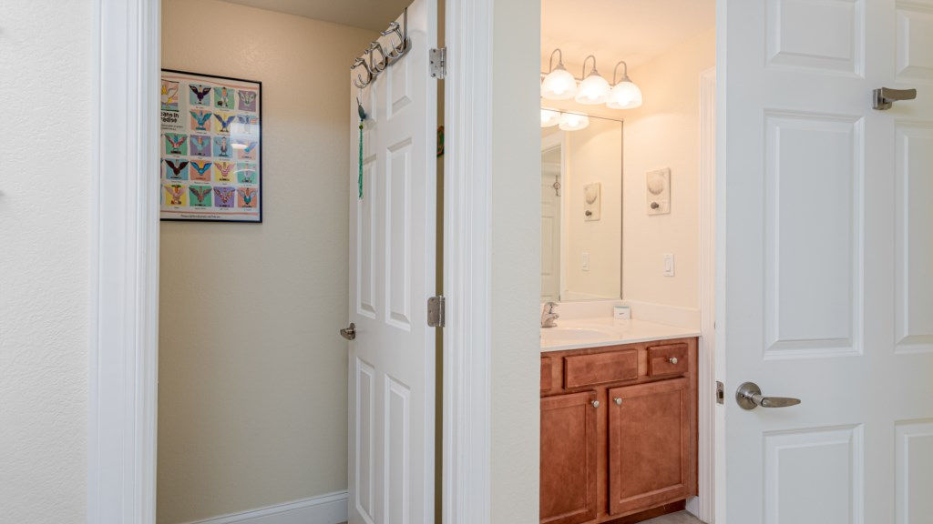 Two separate vanity areas and a water closet.