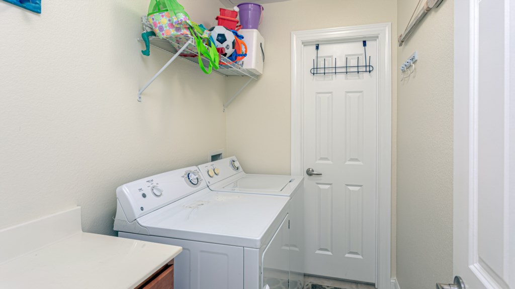 Full size washer and dryer located inside the unit