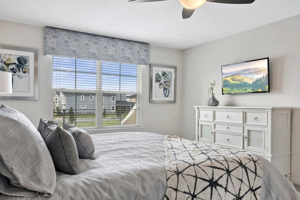 Master Bedroom - Flat screen mounted TV