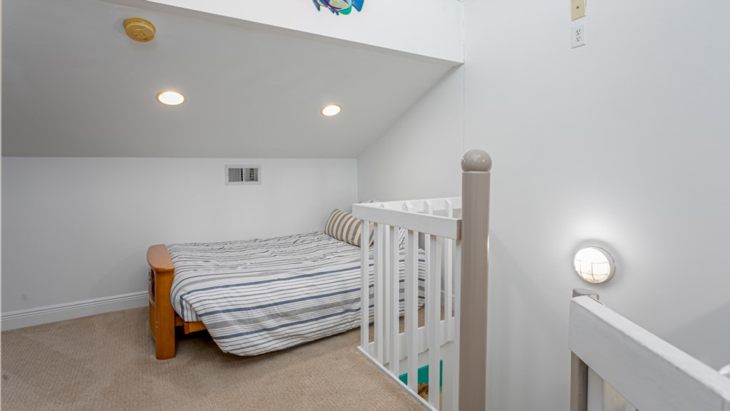 Third level loft area with twin futon beds is the perfect hideaway