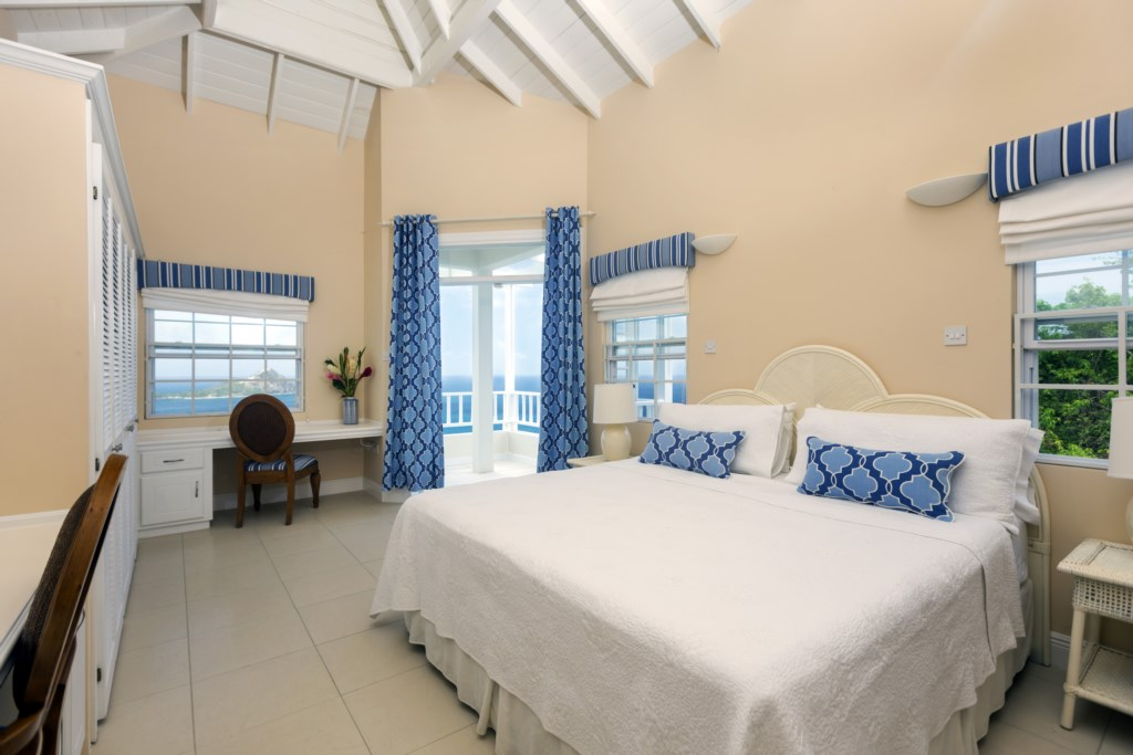 Second bedroom with flat screen TV, ensuite bath with tub and private balcony