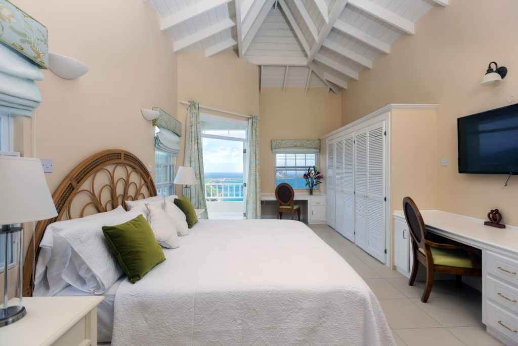 Masterbed room with flat screen TV, ensuite with tub & private balcony