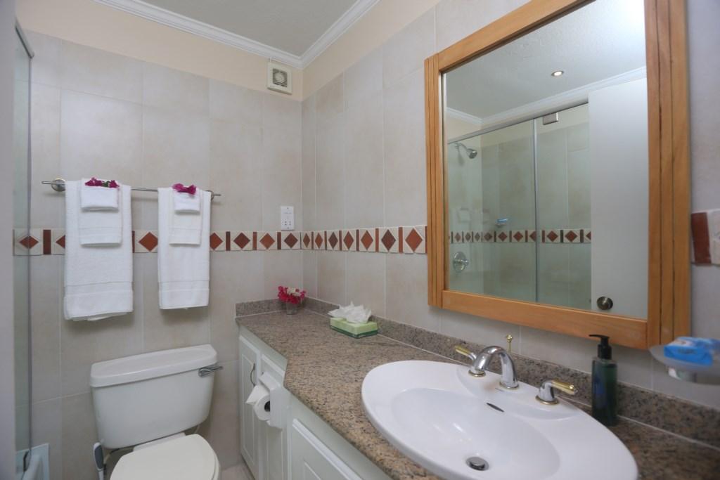Twin room bathroom with shower & tub combo.