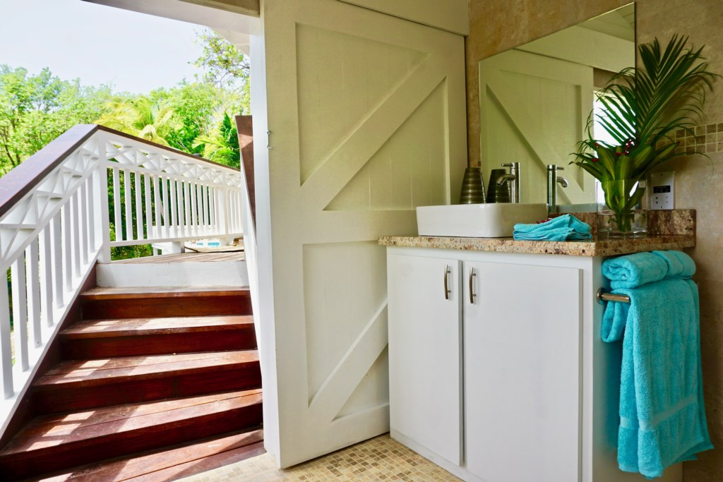 Coconut cottage bathroom, steps from the bedroom