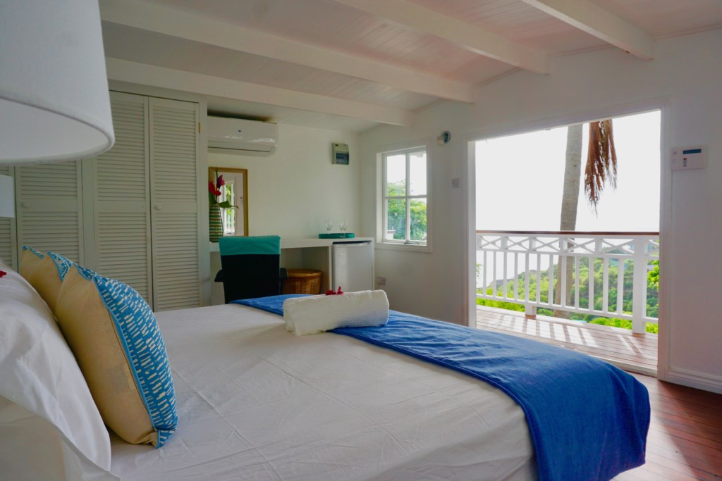 King bed in coconut cottage with a mini fridge