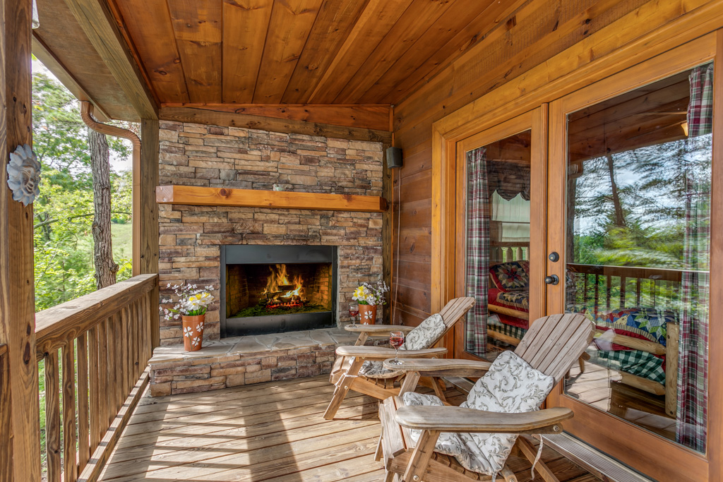 Outdoor fireplace located on the deck right outside of Master Bedroom