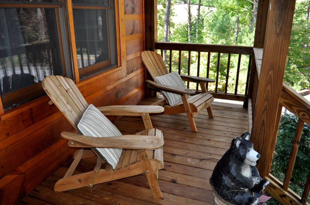Comfortable adirondack chairs on the front porch