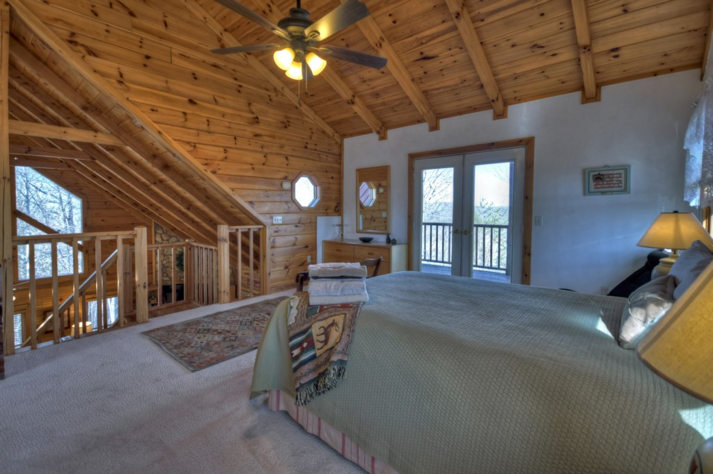 Queen Bedroom on Loft level with deck access