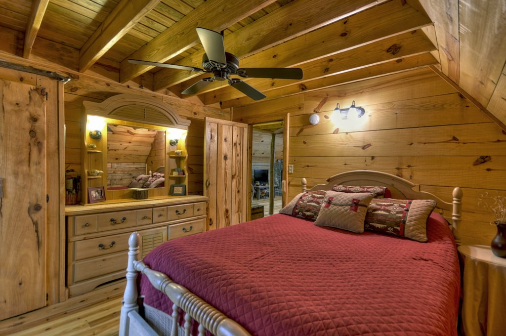 Spacious Bedroom with storage and ceiling fan