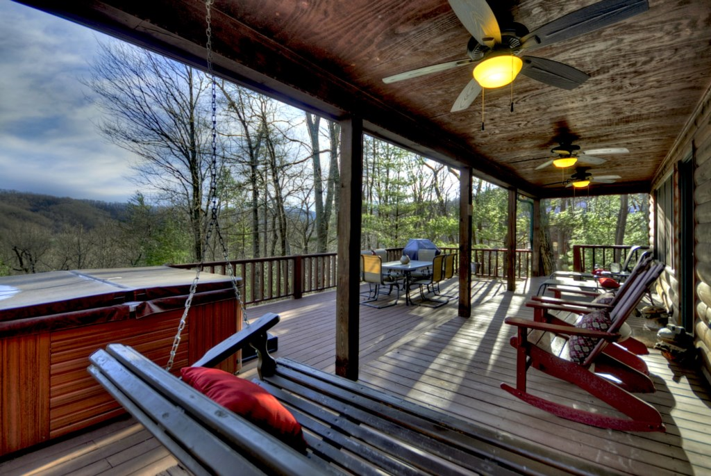 Plenty of covered porch space to soak in the long range view