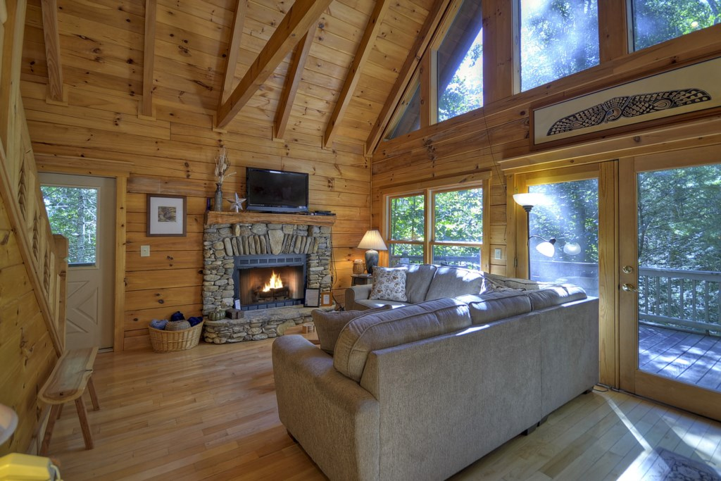 Large vaulted ceilings, comfortable seating and fireplace make this a very cozy space