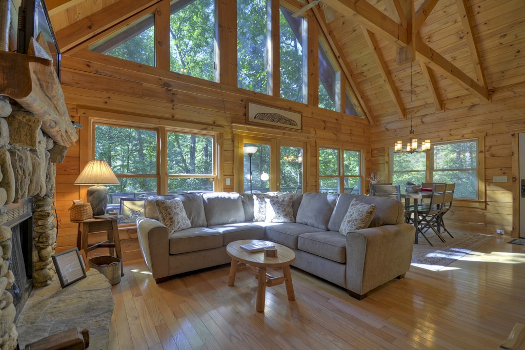 The large windows and french doors brings in the serenity of the woods outside