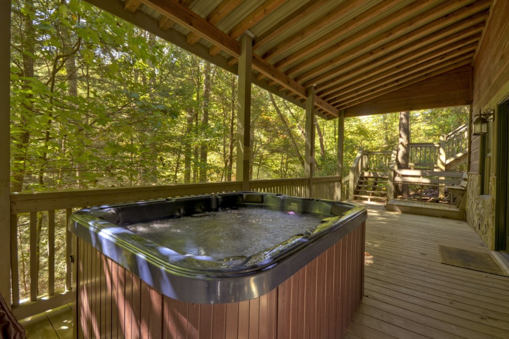 Soak and unwind in the hot tub located off Terrace level