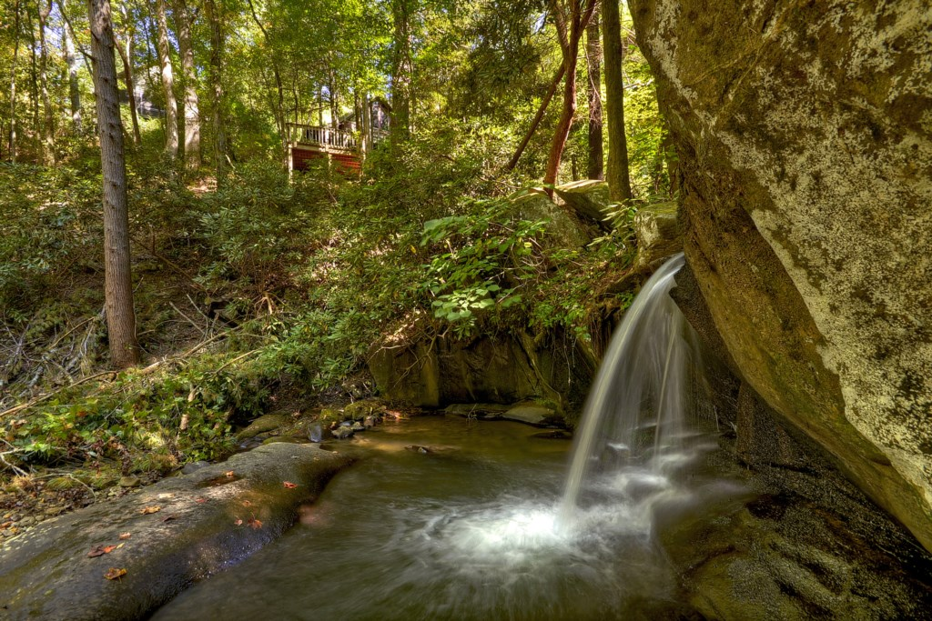 Gorgeous 10 ft waterfalls & loud creek frontage