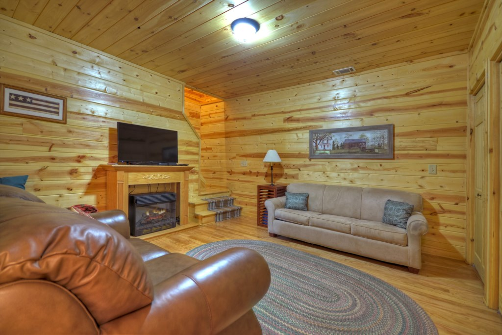 Enjoy a second area to sit back and relax on the cozy sofas in the Den