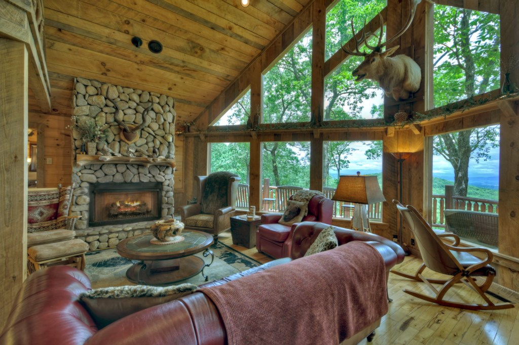 Large cozy Sitting Room with stone fireplace and breathtaking views from the large windows