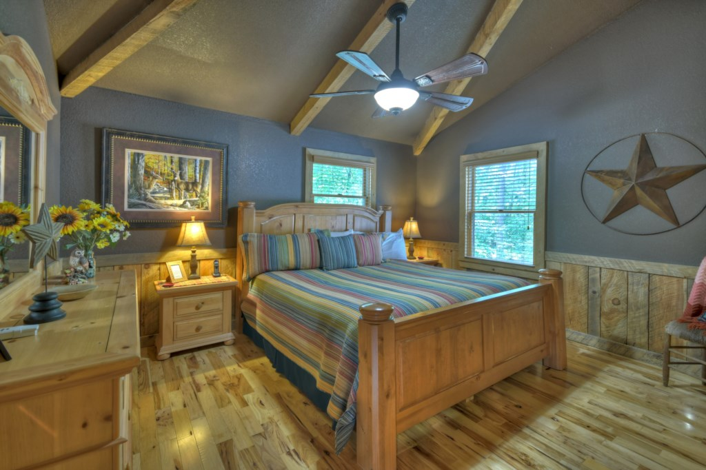 Beautiful King Bedroom with vaulted ceiling and beams