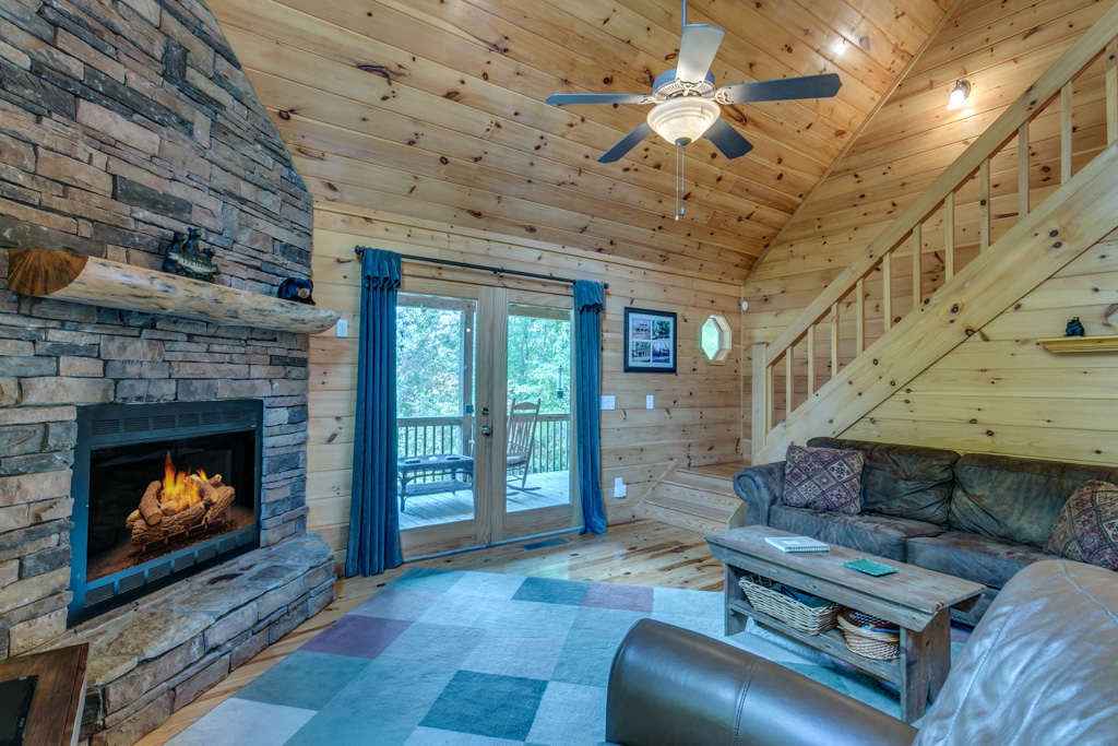 Cozy gas log fireplace in Treetops Den for cuddling