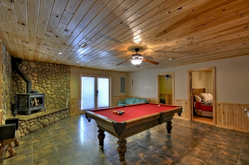 The Game room offers walk out access to the hot tub and patio area