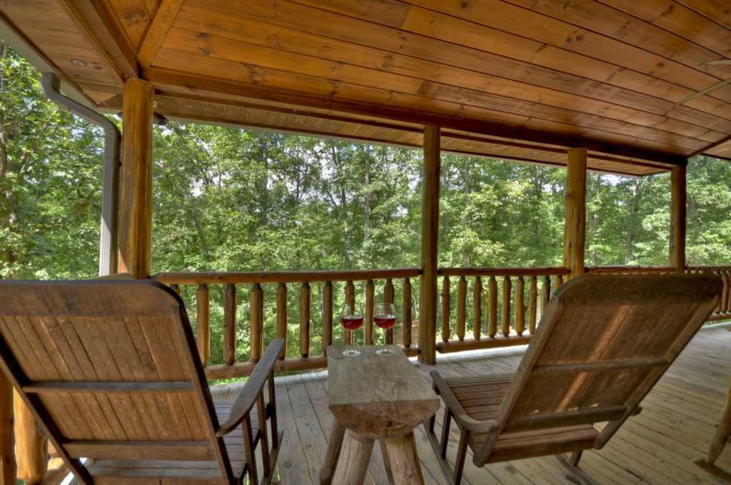 Relax & unwind under the covered wrap around porch