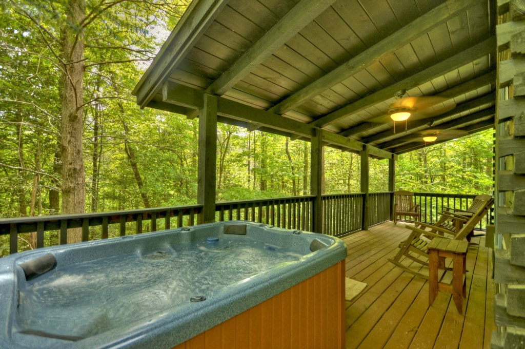 Hot tub privately located on the back deck