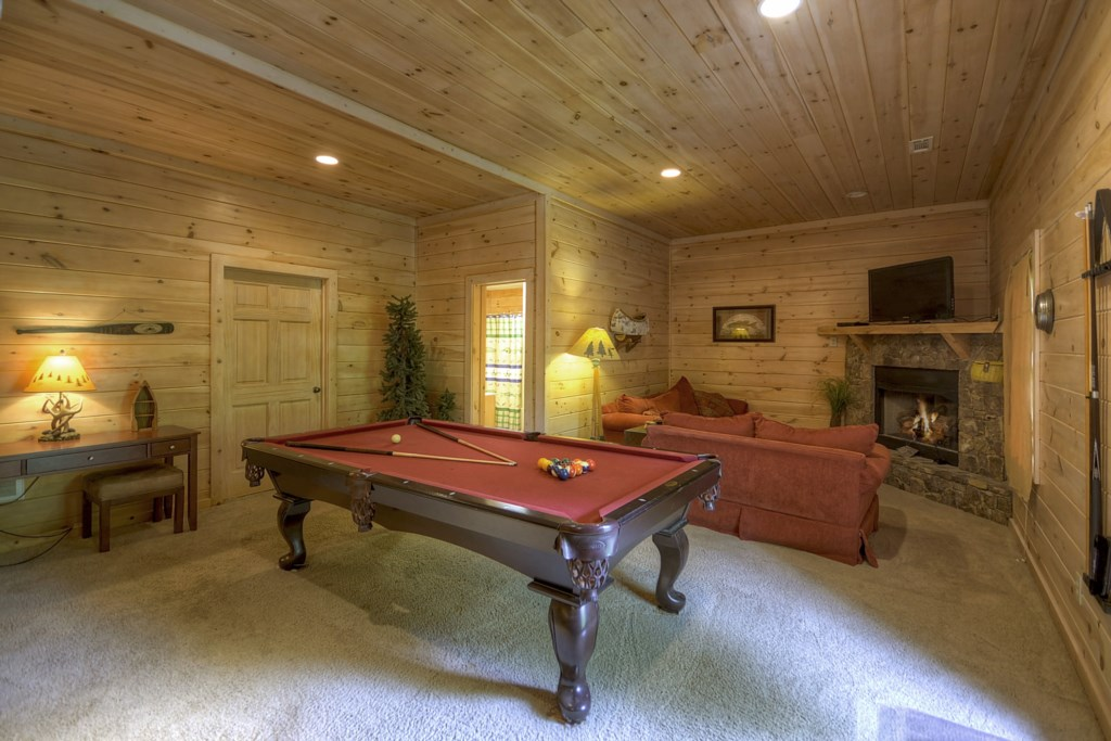 Terrace level Den/Game room with comfy seating, fireplace and TV