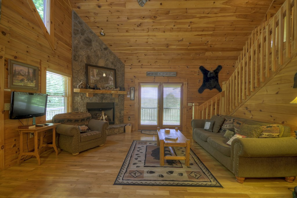 Access to outdoor seating & hot tub from cabin Great Room