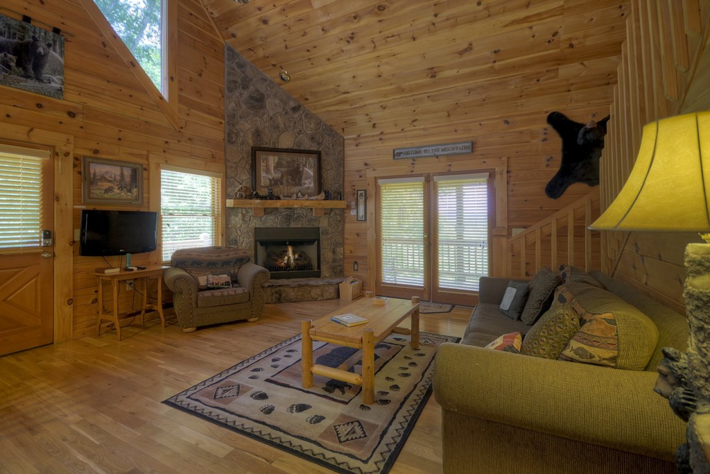 Cabin great room with a cozy gas log fireplace to relax