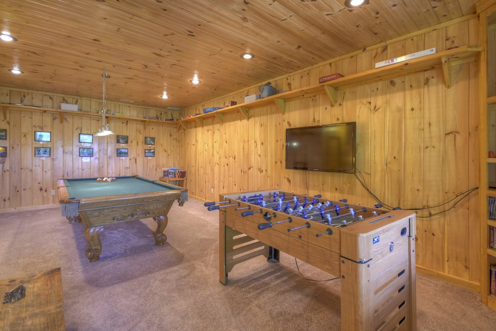 Stocked game room with multiple tables, what a great place to pass the time on a rainy day