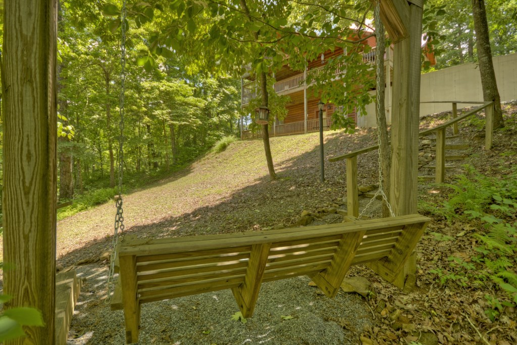 A second porch swing on the path to the Bear Ridge Hideaway fire pit
