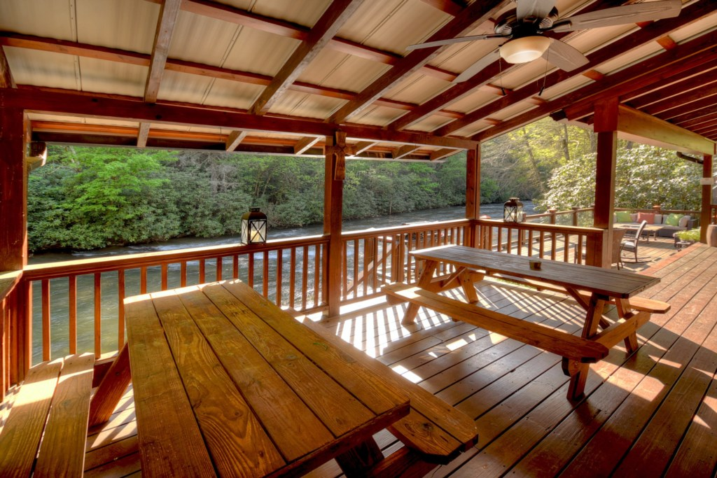 Gather around the shaded picnic tables overlooking the River